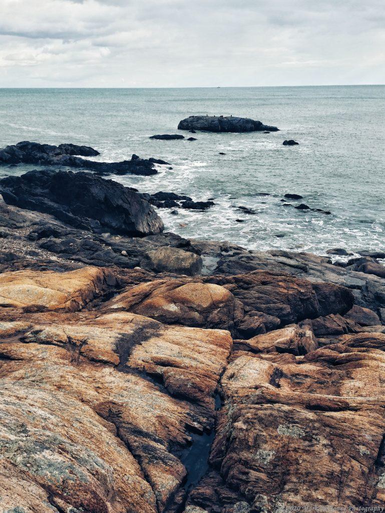 Image of a gloomy rocky shoreline scene.