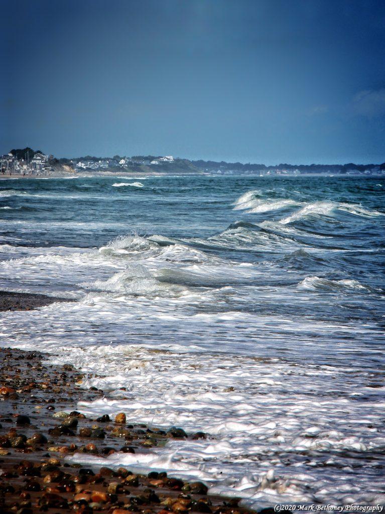 Ocean waves approach the beach.